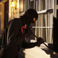 Why are some houses targeted by burglars and not others?